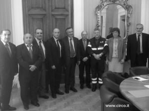 Da sinistra nella foto, Elio Casartelli, Lino Orfei, Pino Piu, Antonio Buccioni, il Viceministro Bubbico, il prefetto Romano, mentre il primo da destra è il prefetto Priolo